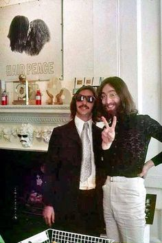 John Lennon and Ringo Starr ... Look at Fire Place ... cool