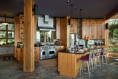 Riverbend Timber Framing - Kitchen,  Combining Curves and Angles  http://riverbendtf.com/