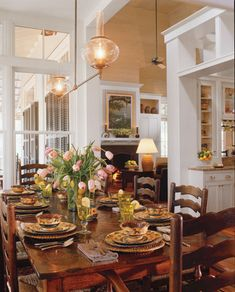Historical Concepts dining room in Coastal Living with lovely ladderback chairs.  Dining open to kitchen and living areas.