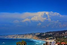 Summer time thunderheads over La Jolla Shores beach and Scripps Pier.