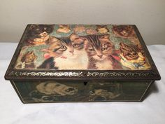 Another Henriette Ronner tin although this one has cats decoupaged on the lid, probably done recently rather than when the tin was new, over the original picture of a mother cat & her kittens.