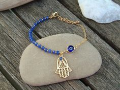 Sapphire Hamsa and Evil Eye Charm Bracelet by cocolocca on Etsy