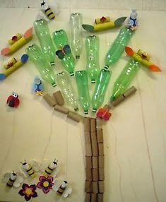 Great for recycling and Earth Day project! This would make a fabulous bulletin board too. Attach with glue dots or hot glue. Earth Day Projects, Earth Day Crafts, Preschool Classroom, Preschool Activities, Interactive Activities, Kindergarten, Colegio Ideas, Diy Recycling, Recycling Projects For School