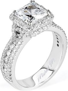 Michael M. Triple Row Diamond Engagement Ring  : This diamond engagement ring features a single row of round brilliant cut diamonds channel set in between two rows of pave set diamonds leading up to the center stone of your choice accented with a pave halo and basket.