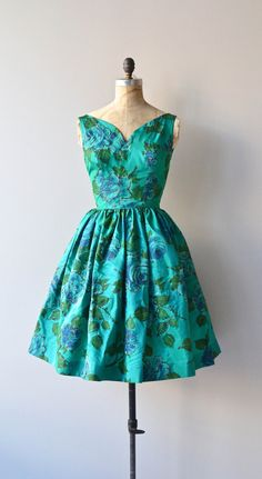 ✩ reserved for barbraeg ✩ please do not buy ✩  ✩ reserved for barbraeg ✩ please do not buy ✩  ✩ reserved for barbraeg ✩ please do not buy ✩        ✩ reserved for barbraeg ✩ please do not buy ✩  Vintage 1950s, early 1960s rich emerald green taffeta party dress with flattering wide neckline and shoulder straps, slight sweetheart bodice, nipped waist, deep V back, emerald glitter outlined floral print, very full skirt and metal back zipper. ✂-----Measurements    fits like: small  bust: 34…
