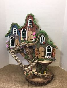 Pixie village cottages gallery miniature fairy garden boot home Fairy Tree Houses, Fairy Village, Fairy Garden Houses, Gnome Village, Fairies Garden, Fairy Gardening, Fairy Crafts, Garden Crafts, Pixie