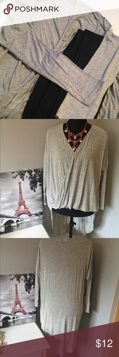 🆕Grey Swoop Top Cute top to wear with leggings. Longer in back than in front. Has a swoop front detail and long sleeves. Not see through, but light enough material for spring months to come. chiccouture Tops Blouses