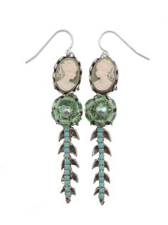 The charm of yesteryear with a twist, these dangles add a bit of contemporary pizzazz.  Green cameos sit atop a setting of green faceted Czech crystal beaded flower motif—all on a silver-tone metal stem with leaves, dotted with turquoise glass beads.