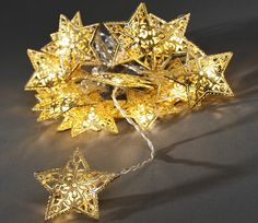 A set of 16 shiny gold filigree metal Christmas stars brought to you by…