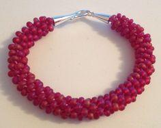 Matte red beaded Kumihimo bracelet by Jewellery by Janine https://www.facebook.com/JewelleryByJanine