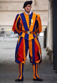 A member of the Swiss Guard at Vatican City in Rome. The uniforms were designed by Michelangelo and are still being used today.