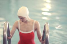 Swimmer in a Red Suit by Lucy Snowe - Woman on a pool ladder in red vintage suit and white bathing cap Girls Swimming, Swimming Pools, Pool Fotografie, Swimming Pool Photography, Female Swimmers, Vintage Bathing Suits, Jolie Photo, Bathing Beauties, Photos