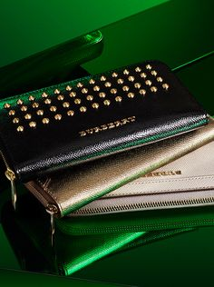 Stud, leather and metallic wallets from Burberry