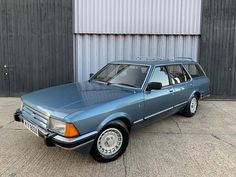 A FORD Granada previously owned by the Queen Mother could be yours for just The humble estate car was also regularly used to ferry Princess Diana and Pri Ford Granada, Car Brochure, Ford Classic Cars, Old Fords, Queen Mother, Ford Escort, Station Wagon, Princess Diana, Motor Car