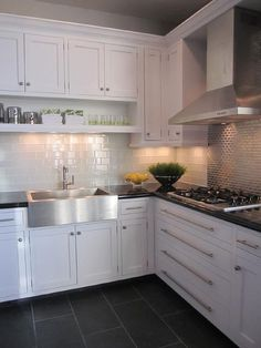 White kitchen - white shaker cabinets, dark countertops, white subway tile backsplash, grey tiles behind range, dark slate or tile floor Farmhouse Kitchen Decor, Kitchen Redo, Kitchen Tiles, Kitchen Flooring, New Kitchen, Farmhouse Sinks, Stainless Steel Farmhouse Sink, Stainless Sink, Kitchen Interior