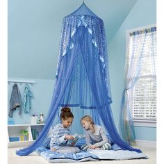 When kids step through the entry of this gauzy blue hideaway dotted with tiny stars, a magical world materializes. Bright LED string lights attached at the top lend an ethereal glow to the room, while shiny ribbon trim adds to the enchantment. Imported. Requires 3 AA batteries (not included).