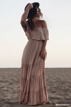 735736561882 A woven maxi dress featuring a flounced off-the-shoulder neckline