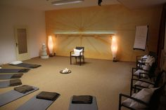 Get Relax With These Meditation Room Designs Collection : Appealing Meditation Room Design Idea with Nice Grey Cotton Meditation Mat and Black Chairs also Two Unique Shaped Floor Lamp