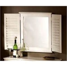 <p> Escape to the beach with this driftwood shutter mirror. Shutter mirror is a perfect addition to a coastal themed room such as a bathroom, bedroom or special beachy place. Wall or table top mirror.<br /> <br /> Made in USA<br /> <br /> 25.5 x 46.75 x 3 inches</p> <p> Color Shown is Old World White (OWW)</p>
