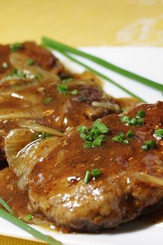 An easy-to-make classic featuring tasty hamburger 'steaks' smothered in gravy and onions. It's a great way to dress up a pound of ground beef, and you probably have all the ingredients on hand! Hamburger Steaks, Hamburger Steak Recipes, Hamburger Dishes, Beef Steak, Pork Recipes, Cooking Recipes, Easy Cooking, Cooking Games, Healthy Recipes