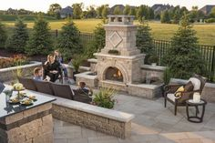 Brussels Dimensional Fireplace with Umbriano Paver and Ledgestone seat wall
