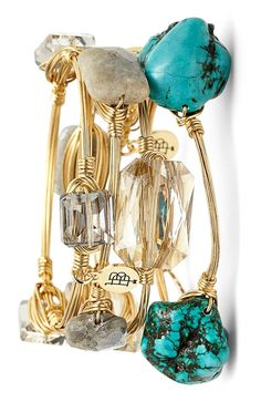 This turquoise-dyed bracelet with shiny, dramatic stones adds a luxe touch to any ensemble.