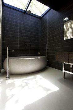 Contemporary Full Bathroom with limestone floors, Signature Hardware Flavius Oval Travertine Tub, Skylight, Freestanding