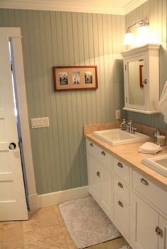 Loving this idea for the basement bath...maybe floor to ceiling behind toilet and sink...and up to chair rail height elsewhere...hmmm...