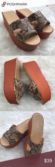 "NIB Belladonna Tan Python Candy Leather Platform New in box Donnabella Tan Python Candy Leather Platform Slide. Size 9. Has a 3.5"" heel with a 2.75"" Platform. Leather upper, leather lined with a man made sole. No trades, offers welcome. Donnabella Shoes Platforms"