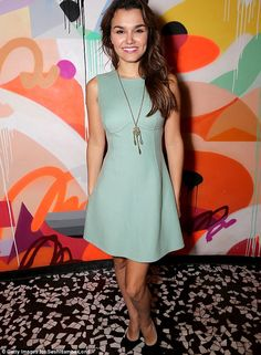 Dressed up: Samantha  looked lovely in green skater dress and contrasting black court shoes