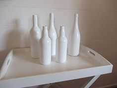 LOVE THE WHITE!!! - DIY Wine Bottle Centerpieces - Wedding Inspiration and Wedding Advice