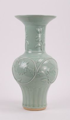 CHINESE CELADON PORCELAIN VASE WITH MOLDED LOTUS 19th century; 16 in. h, 7 1/2 in. diameter