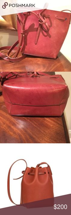 Mansur Gavriel mini bucket bag Good condition. Light wear and tear at the bottom corners. Brown vegetable tanned leather. Mansur Gavriel Bags Crossbody Bags