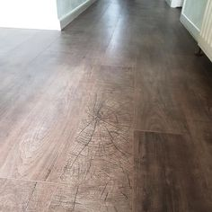 One of our new walnut laminate floors fitted this week . We love the feature board that pops up randomly throughout the floor it really makes this floor into something special!  Why not call in and see what we can do for your home? #floor #home #hallway #laminate #walnut #wood #woodenfloor #interior #instahome #interiordesign #style #design #banbridge #codown #house #decor #customerservice #homedecor