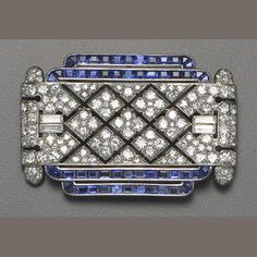An art deco diamond sapphire and platinum brooch Lacloche Frères circa 1925