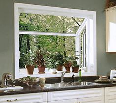 Another way to bring the outside in... a garden window. Herbs in  Greenhouse  KitchenMini GreenhouseGarden ...