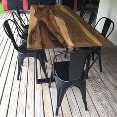 Dining table in solid guayubira wood and iron legs. Even though historical in idea, this