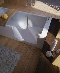 Clever walk in bathtub. Especially for elderly.  Hate to see it leak on those timber floors though