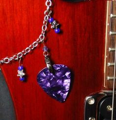 Functional guitar pick necklace...need this when I'm teaching - I always loose my guitar pick!