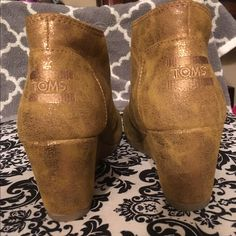 Gold/brown toms wedges size W 6.5 Lightly used toms wedges, very cute with a summer dress, or any outfit. TOMS Shoes Wedges