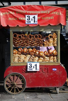 "Street Food Stall in Ankara Turkey by SpirosK photography, via Flickr...........aka ""the Life Savers""! These stall sell bread/cheese products, at 3 pieces per Lira (1 Lira = 0,5 Euro).    And they are all around the city! A real life saver when hungry!!"