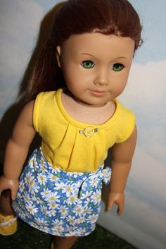 18 Inch Doll (like American Girl) Blue and Yellow Daisy Print Sarong Skirt with Yellow Tank Top - Blue and yellow daisy sarong and yellow pleated top by SewLikeBetty on Etsy. Made following the Aloha Sarong Skirt and the Aloha Pleated Top and Dress patterns. Find them at http://www.pixiefaire.com/products/aloha-sarong-skirt-18-doll-clothes. http://www.pixiefaire.com/products/aloha-pleated-top-and-dress-18-doll-clothes. #pixiefaire #alohasarongskirt #alohapleatedtopanddress