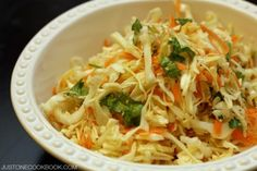 Asian style coleslaw with sesame oil and cilantro, it's easy to make and tastes very refreshing, pair with seafood or BBQ meats!