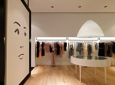 Fashion Boutique Interior Design Inspiration. I like the inset rails with the back ground lighting.