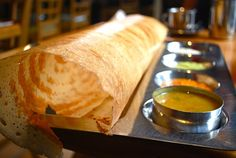 Dosa: a traditional South Indian crepe with a variety of chutney dipping sauces