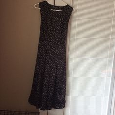 Like new dress!! Gorgeous dress by Kristen Davis. Pics don't do it justice, black with white polka dots. Pretty pleated design in front and back. Zips on the side, with ribbon tie in the back. Satiny feel to it. Worn maybe 3 times! Dresses