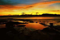 Sunset at Tanjung Aan.  Tanjung Aan beach is known for its  stunning sunset scenery. A cup of coffee or a glass of beer w...