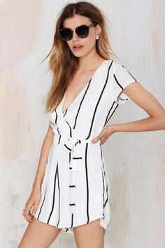 Lioness Roman Holiday Crepe Romper will have your classic beauty in full effect.