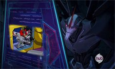Transformers Pime Starscream watching video of  1980's Starscream