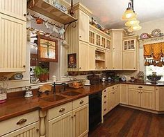Copper and Cream Kitchen/The kitchen was remodeled in 2000 and features handmade copper counters/The Betty Crocker Estate- post written by Jane T for Atticmag